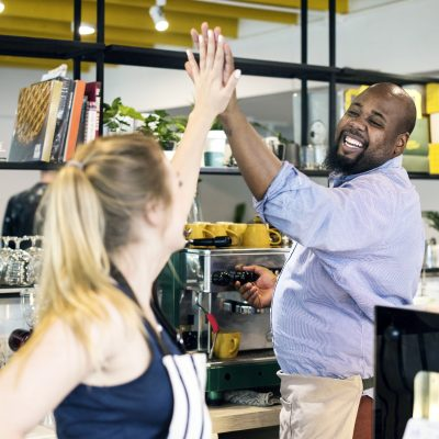 colleagues-give-a-high-five-to-each-other